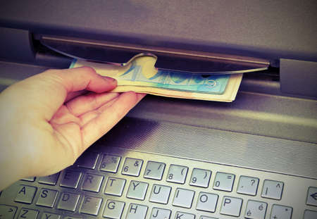 boy takes the money with hand at ATM with old effect