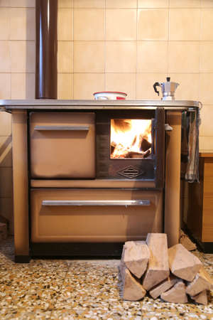 red fire lit in a stove with wood to burn out Stock Photo