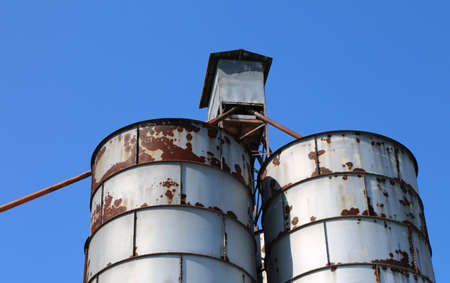old abandoned metal silos used once to contain animal feed
