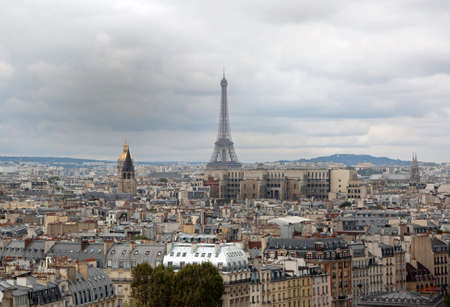 Panorama of Paris with Eiffel Tower  and golden Dome of Les Invalides from Basilica of Notre Dame