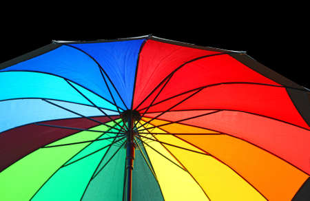 umbrella with the colors of the rainbow open to protect you from the rain