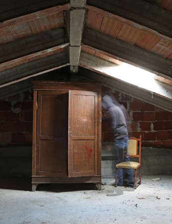 ghost and an old wardrobe in the attic of the abandoned house