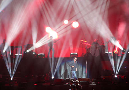 Verona, VR, Italy - September 23, 2018: Concert at Verona Arena of ANTONELLO VENDITTI a famous Italian singer-songwriter with many lights on the stage