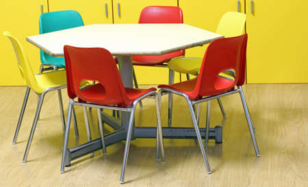 small colored chairs of a kindergarten classroom without children with wooden floor Banque d'images - 112923548