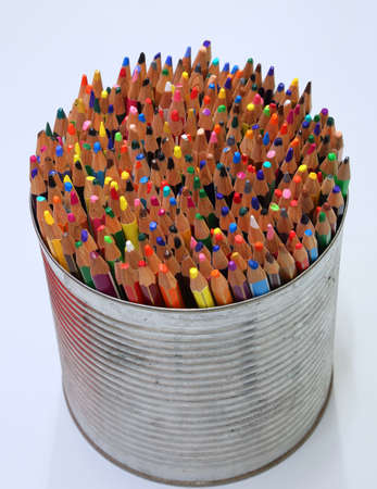 colored crayons in the jar on white background