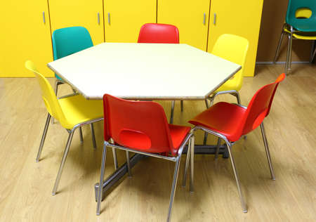 small  chairs in the classroom of the primary school with wooden floor Stock fotó
