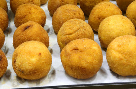 balls of rice are the typical specialty of southern Italy. The balls of rice are fried in the boiling oil