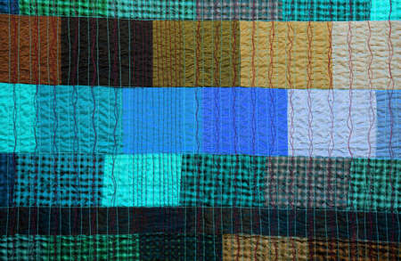 background of patchworks handmade by patient seamstresses