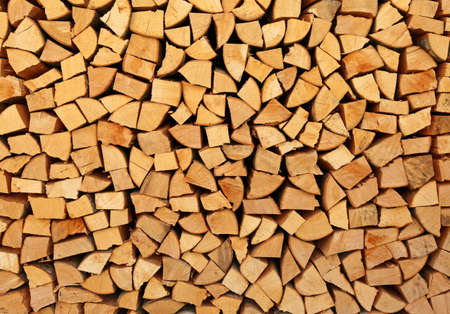 background of stacked wooden logs in the woodshed 免版税图像