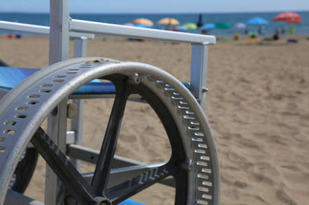 detail of a wheelchair with modified wheels to be able to go on the beach sand Stock Photo - 116362237