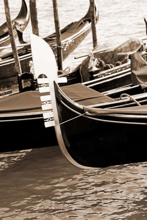 Gondola in the Venetian lagoon with sepia toned effect