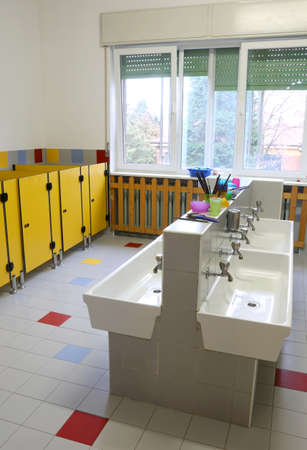 Sinks for cleaning inside the nursery bathroom without the children and small yellow doors