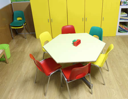 inside the class of a school with small chairs and the hexagonal child-friendly table