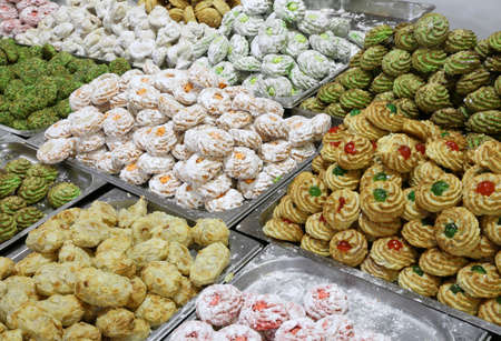 many pastries and cookies made with almond paste and candied fruit for sale on sale in Italian pastry