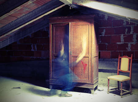 ghostly spirit in a ghost that moves near an old wardrobe in the attic of the abandoned house