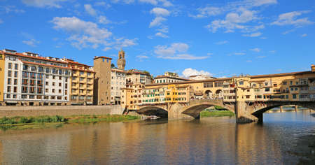 Old Bridge called Ponte Vecchio in italian language in Florence over River Arno