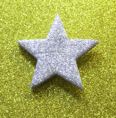silver star in brilliant yellow green gold background