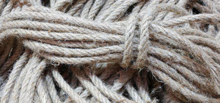 background of skeins of raw strings for sale in haberdashery