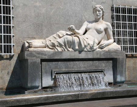 Turin City Fountain with the big statue of a woman representing the river Dora in Northern Italy