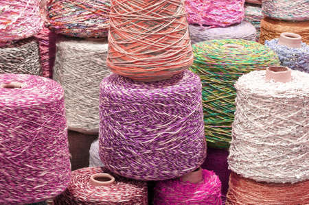 coils and spools of colored wool thread for the creation of handmade sweaters