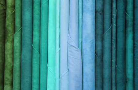 colorful fabrics in the dress shop for dresses or trendy tablecloths Stock Photo