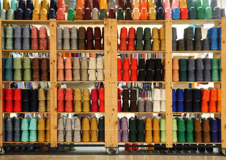 shelf of haberdashery with threads and wadding for sale Banque d'images - 114140248