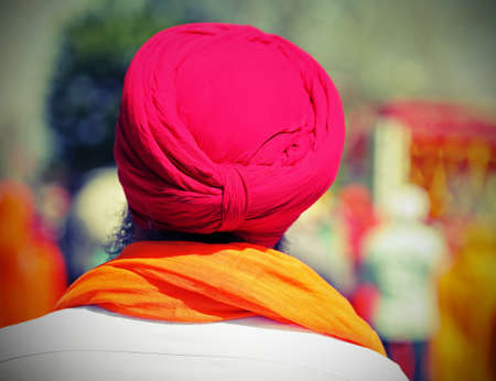 sikh man with long beard and red turban