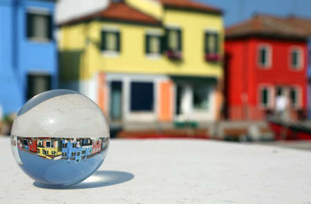 large glass ball with the houses of the island of Burano near Venice in Italy