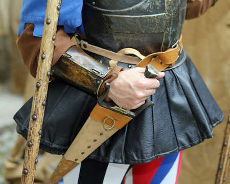 medieval soldier holds a dagger at a historical re-enactment Stock Photo