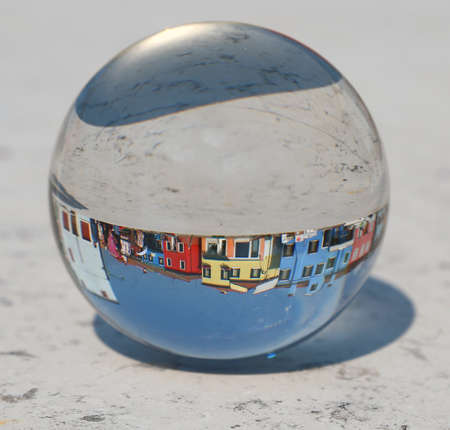 large crystal ball where the colorful houses of the island of Burano are located near Venice in Italy 스톡 콘텐츠