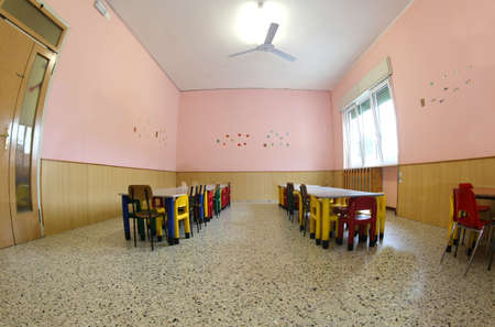 little chairs and tables of a refectory of the kindergarten without the kids