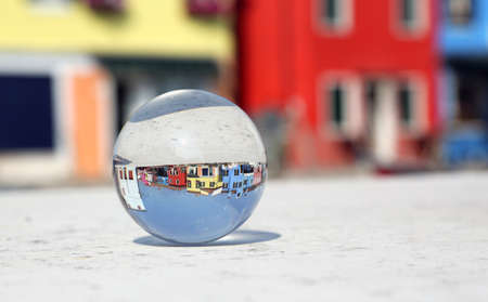 big crystal ball with the houses of the island of Burano near Venice in Italy Standard-Bild