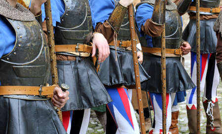 medieval soldiers with the weapon and armor during a historical re-enactment