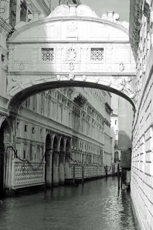 Bridge of Sighs called Ponte dei Sospiri in Italian Language in Venice in Italy. The enclosed bridge is made of white limestone, has windows with stone bars and connects the New Prison  to the interrogation rooms in the Ducal Palace