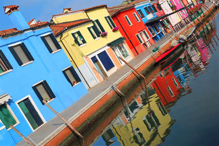 houses with vivid colors on the Italian island of Burano near Venice. The photo is intentionally inclined to give a little liveliness at the picture