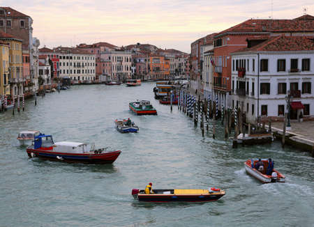 Grand canal in Venice in Italy also called Canal Grande in Italian Language with many boats in morning