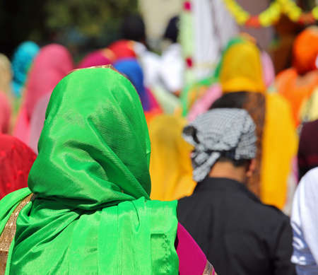 woman with veil on head during religious sikh procession outdoors