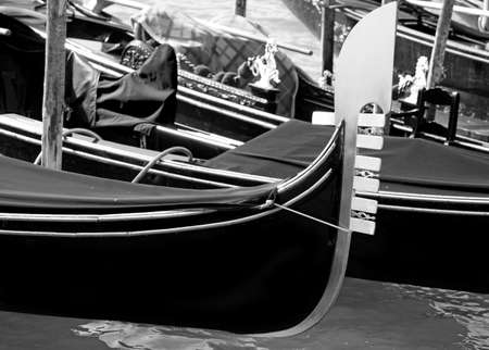 bow of the boat to transport tourists to Venice in Italy called Gondola moored on the Grand Canal