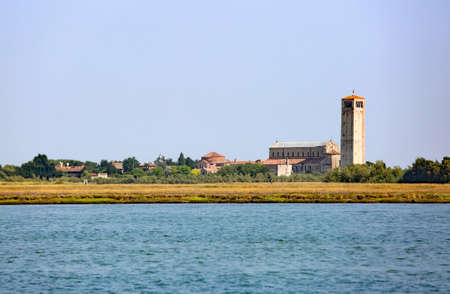 ancient bell tower in the island called TORCELLO near Venice in Northern Italy 免版税图像