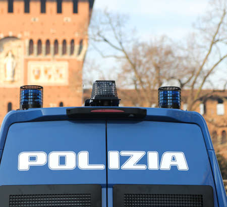 armored police van in front of the Castello Sforzesco in Milan in ITaly to patrol against terrorist attacks Stock Photo