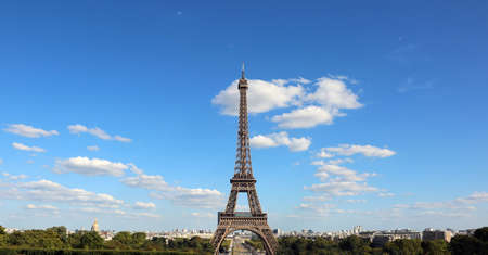 Eiffel Tower from Trocadero Area with clouds on blue sky