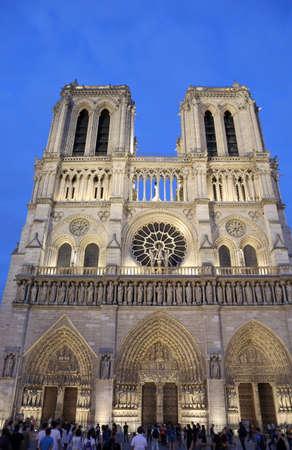 illuminated facade of the gothic church of Notre Dame de Paris at night
