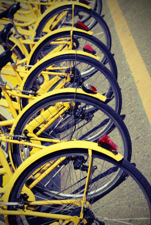 yellow bicycles for the bike rental system in the city called bike sharing