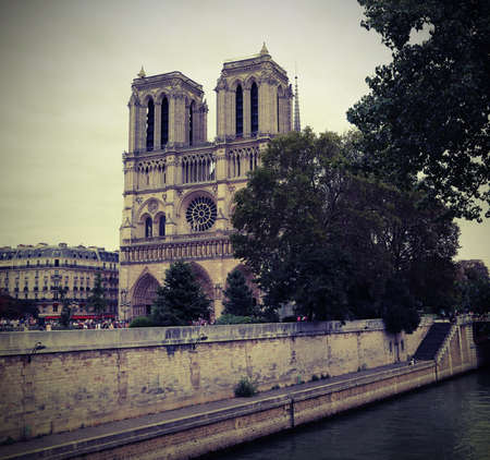Notre Dame de Paris and Seine River in France with vintage old toned effect 写真素材