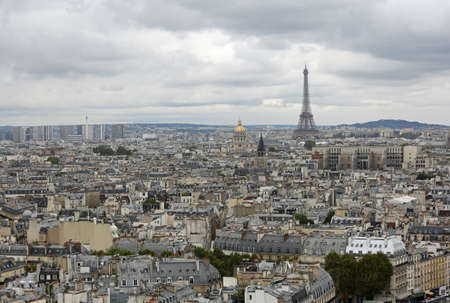 Urban Panorama of Paris in France with Eiffel Tower and Golden Dome of Les Invalides Monument