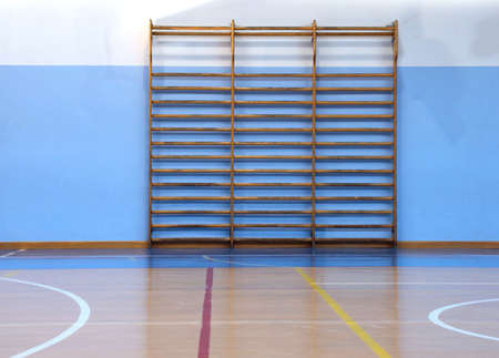 wooden wall bars in the big empty gym without the athletes Stock Photo
