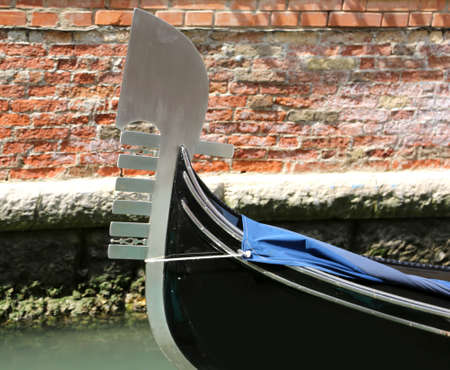 bow of the boat to transport tourists to Venice called Gondola. The shape of the bow represents the seven districts of the island called Sestieri in Italian language