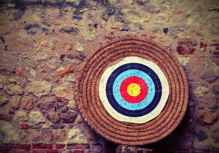 big target with concentric circles to train during the archery competition with vintage old toned effect Stock Photo