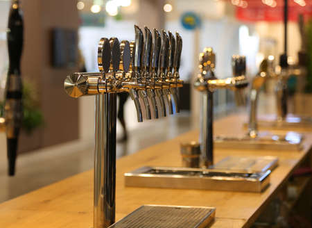 many draft beer taps on the counter of an Irish pub Stok Fotoğraf