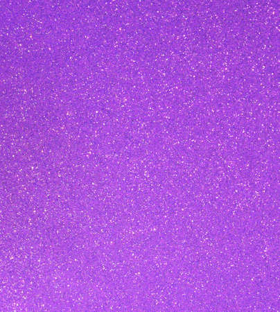 purple background with lots of bright shiny glittering ideal as a backdrop in horizontal format